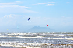 Kitesurfing on beach Rasa in Armacao dos Buzios near Rio de Jane Royalty Free Stock Images
