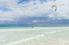 Kitesurfing in the beautiful sea. Kitesurfer in action on clear blue tropical water, Mexico Stock Photo