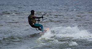 Kitesurfing in cold water Stock Photography