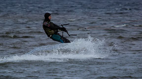 Kitesurfing in cold water Royalty Free Stock Photos