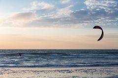 Kitesurfing in the evening along the Dutch coast. Kite surfing in the evening along the Dutch coast Stock Photography
