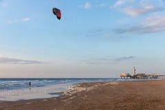 Kitesurfing in the evening along the Dutch coast of Scheveningen Stock Photo