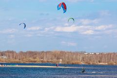 Kitesurfing in the flooded meadows during the high water on a bright sunny day. royalty free stock images