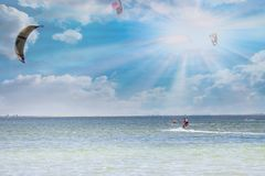 Kitesurfing. Girl rides a kite at sunny day royalty free stock photos