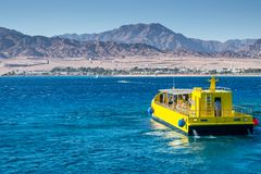 Kitesurfing and glass boat in Dahab Egypt royalty free stock images