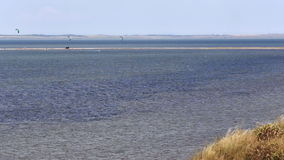 Kitesurfing kite surf Sea coast beach wave tide stock video footage