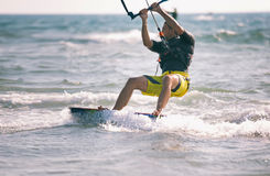 Kitesurfing, Kiteboarding action photos, man among waves. Quickly goes Stock Photography