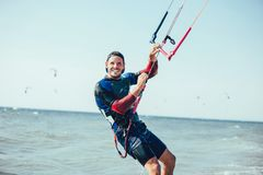 Kitesurfing Kiteboarding action photos man among waves quickly royalty free stock photography
