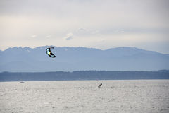 Kitesurfing kiteboarding surfing  Royalty Free Stock Images