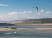 Kitesurfing in the Lagoa da Albufeira. Kitesurfing or kiteboarding is a surface water sport combining aspects of wakeboarding, windsurfing, surfing, paragliding Royalty Free Stock Photography