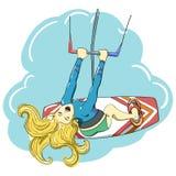 Kitesurfing lycklig banhoppningflicka Arkivbild