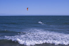 Kitesurfing at Malibu Beach, CA. Kite surfer hits the waves just offshore in Malibu, California Royalty Free Stock Images
