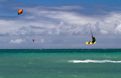 Kitesurfing on Maui 2. Surfer on a bright yellow kiteboard performing high jump, Maui, Hawaii Stock Image