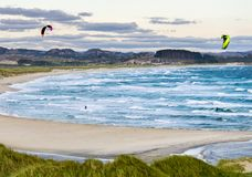 Kitesurfing men in action on stormy sunset evening at Brusand Beach, Norway. Stock Photos