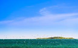 Kitesurfing New Caledonia. Kitesurfing around the tropical island Ilot Maitre in New Caledonia Royalty Free Stock Photography