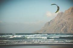 Kitesurfing. In ocean near mountain Stock Photography