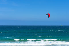 Kitesurfing ocean waves on sunny day royalty free stock images