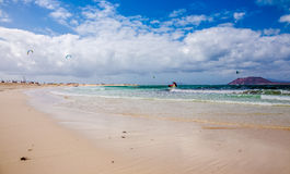 Kitesurfing. Photography of kitesurfing on Corralejo beach, Fuerteventura, Canary Islands, Spain Stock Image