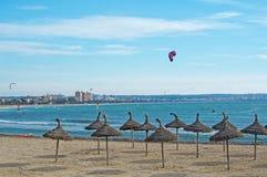 Kitesurfing Playa de Palma. PLAYA DE PALMA, MALLORCA, SPAIN - DECEMBER 14, 2017: Kitesurfing on the winter beach on a windy day on December 14, 2017 in Mallorca Royalty Free Stock Image