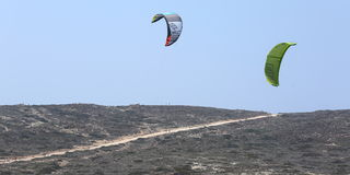 Kitesurfing in Prassonisi, Aegean sea, Rhodes Island Royalty Free Stock Images