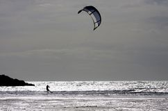 Kitesurfing at Rhosneiger Stock Image