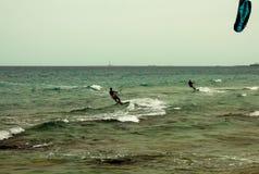 Kitesurfing at sea in Salento in Puglia - Italy. Kitesurfing people at sea in Salento in Puglia - Italy Stock Image