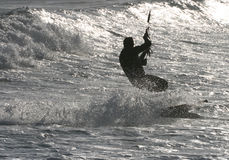 Kitesurfing on sparkling sea Royalty Free Stock Images