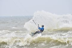 Kitesurfing in spray. Surfer going kite surfing, surfboard splashes bursts of spray. Photography on April 4, 2014 in Zhunan,Taiwan Royalty Free Stock Image