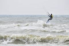 Kitesurfing in spray. Surfer going kite surfing, surfboard splashes bursts of spray. Photography on April 4, 2014 in Zhunan,Taiwan Stock Image
