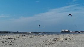 Kitesurfing in St. Peter-Ording stock video