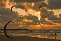 Kitesurfing in the sunset Stock Photo