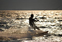 Kitesurfing in the sunset Stock Images