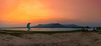 Kitesurfing at the sunset with mountain view Stock Image