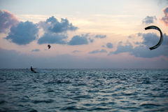 Kitesurfing. Various tricks done by rider on a kiteboard shot at sunset with beautiful backlit Stock Photography