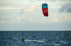 Kitesurfing. In Water at Sjælland Dk.tree blue sky and white clouds Stock Images
