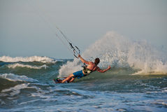 Kitesurfing the waves in Brazil. A kiter surfing in the waves of Guajiru, Brazil Royalty Free Stock Images