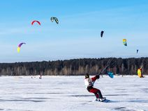 Kitesurfing in the winter. Skating on the ice in the wind. Stock Photography