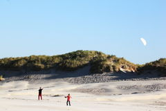 Kiting at beach of Ameland Island, Holland stock images