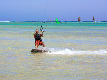 Kiting men. Portrait young man with kiteboard on water Stock Photography