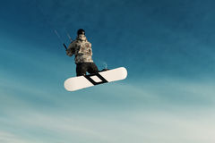 Kiting on a snowboard on a frozen lake Stock Photography
