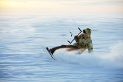 Kiting on a snowboard on a frozen lake Royalty Free Stock Images