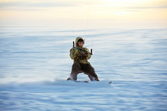 Kiting on a snowboard on a frozen lake. Wintery kiting on a snowboard on a frozen lake Stock Photo