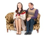 Kitsch couple on sofa Royalty Free Stock Photo