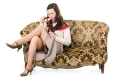 Kitsch woman enticing. Kitsch mature woman enticing on old fashioned sofa stock photos