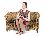Kitsch woman on retro couch royalty free stock images