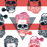 Kitschy seamless pattern. Human skulls with hipster hairstyle and smoking pipe drawn in engraving style against red Royalty Free Stock Photo