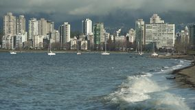 Kitsilano Beach Waves, Vancouver 4K UHD. Kitsilano Beach on English Bay in the morning. In the background are the North Shore Mountains. Vancouver, British stock footage