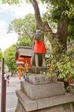 Kitsune fox statue in Fushimi Inari Shrine of Kyoto, Japan. Statue of kitsune in Fushimi Inari Taisha Shinto Shrine in Kyoto, Japan. Kitsune is a fox Royalty Free Stock Image