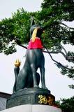 Kitsune or Fox statue for people visit and pray at Fushimi Inari. Taisha shrine of Inari, Fushimi Ku in Kyoto, Japan Stock Photo