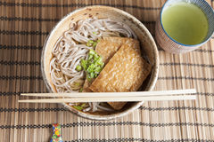 Kitsune soba, Japanese buckwheat noodles with marinated, fried tofu Stock Photography